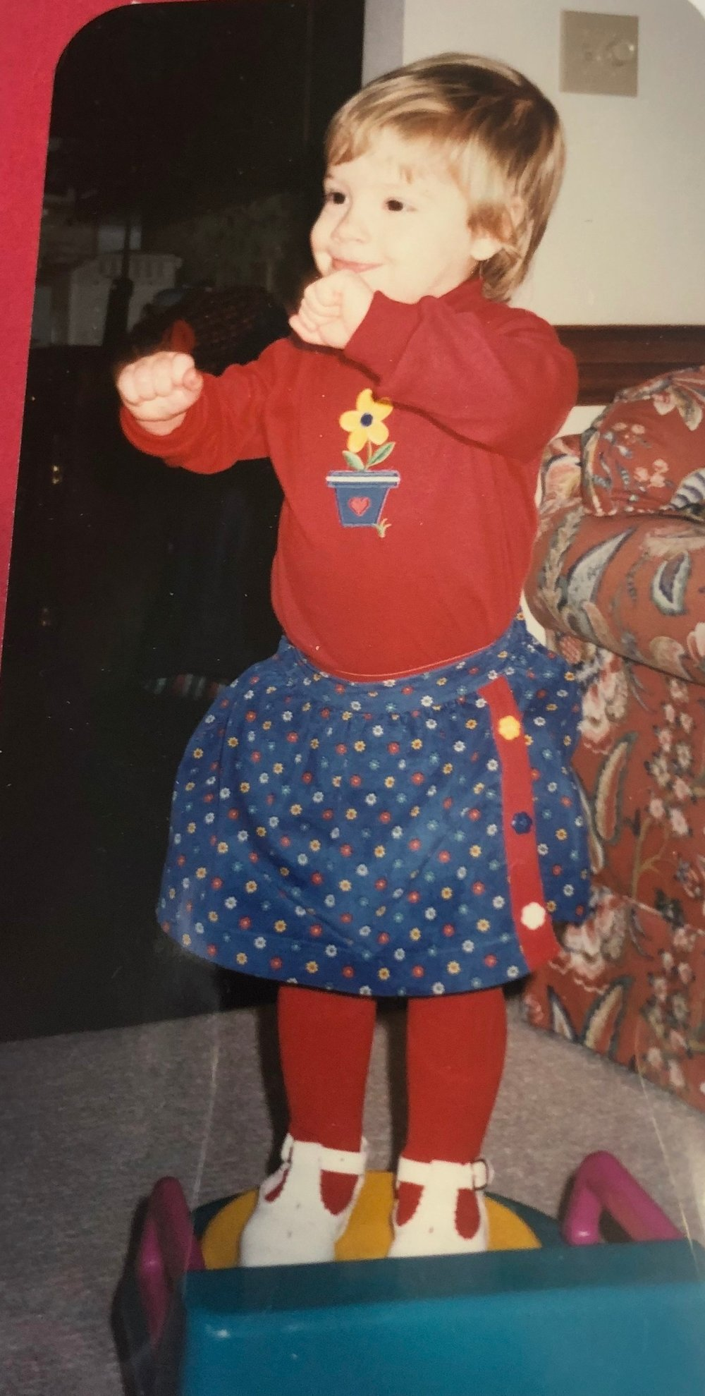Ca. 1996, casually performing a number off the Beauty & The Beast soundtrack for my parents from the comfort of my baby potty. Crushed it! (Also, that couch was ugly. Hey, the 90s were tough.)