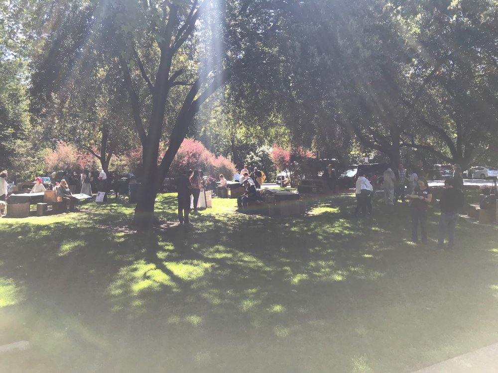 Organizers and early arrivals gather at Civic Park in Walnut Creek, California.