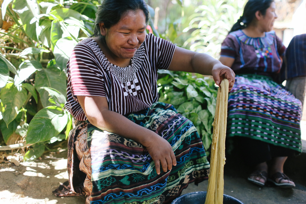 One of the artisan women dying yarn.