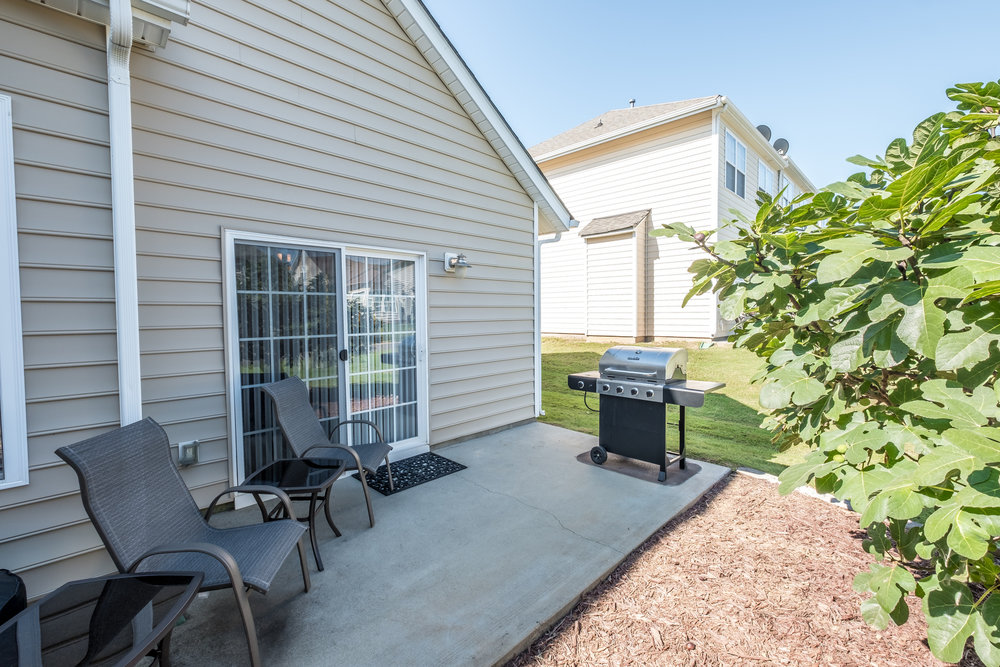 Patio perfect for grilling or enjoying the smell of fresh peaches/figs from your fruit trees