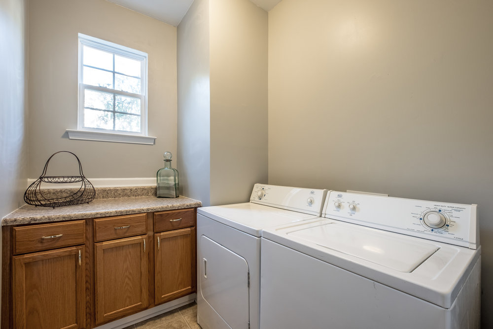 HUGE laundry room with counter space and storage