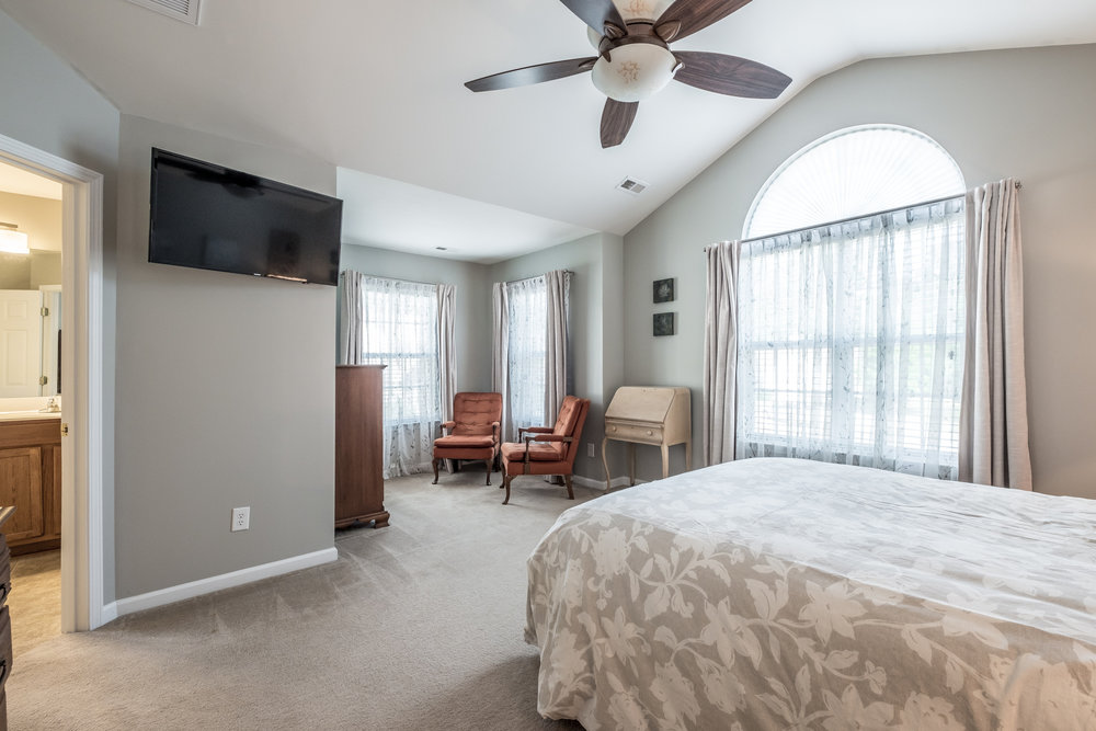 Light soaked master suite with vaulted ceilings, and an extra sitting area
