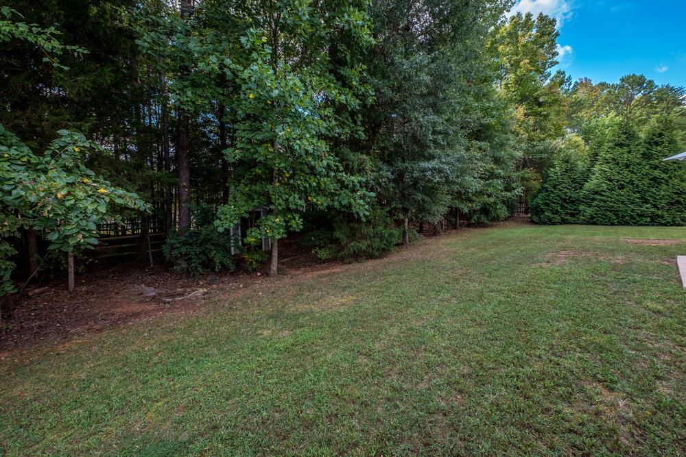 Large fully fenced wooded back yard