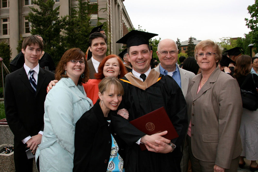 Adam went on to earn his MBA from the Carlson School of Management with an emphasis in finance, driven by his interest in economics. Here he is surrounded by those closest to him. Not pictured are Adam's sister and brother-in-law, who are taking the photo. (Spring 2008)