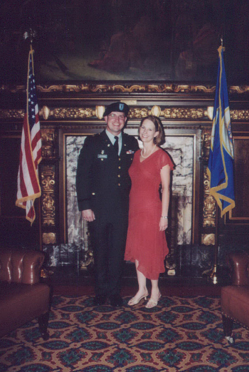 After returning home from Kosovo, Adam attended Officer Candidate School.  Upon receiving his commission to become an officer in the military, his wife pinned his new rank on his uniform in a ceremony held in the Governor's office at the Minnesota State Capitol. (Summer 2006)
