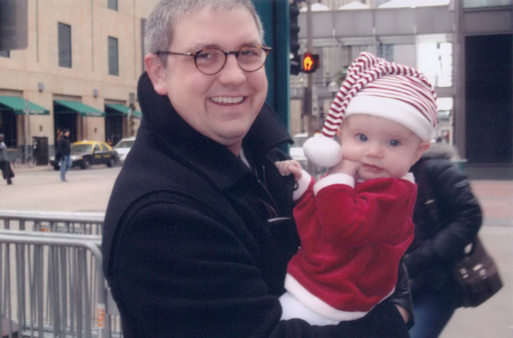 New Dad with Dorothy, our first child, while in Downtown Minneapolis. There is nothing more special than being a father. (Winter 2012)