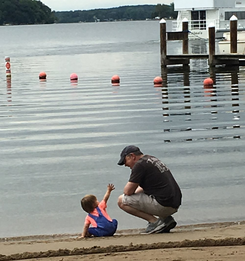 My son Atticus showing me sand at Wekota Beach.  He was fascinated and wanted me to share in it.  Megan secretly snapped this shot on her phone.  (Summer 2016)