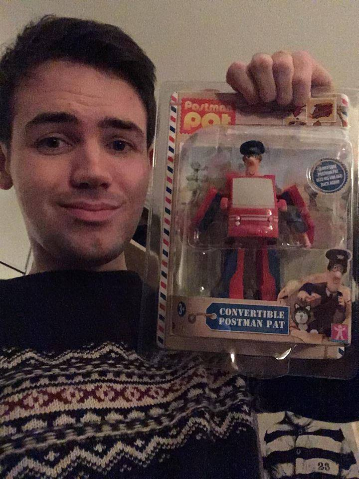 Calvin with his Postman Pat Transformer Christmas gift.