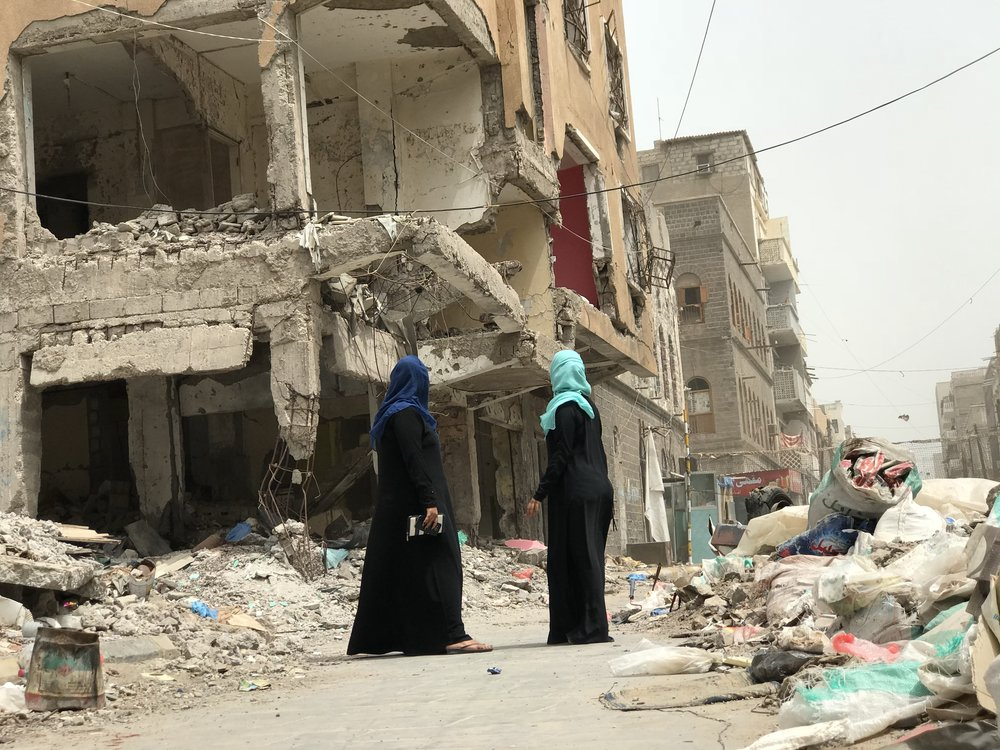 """Staring at the ruins of her house, Rasha """"starring Sally Hamada"""" on the right and her friend. Photo courtesy Ismail Saleem Ismail"""
