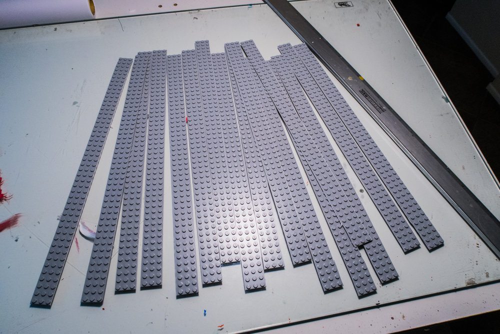 One large grey base plate made enough strips to cover two of the riser units, plus a number of left over strips that I used to make one big bottom plate from 6x8 plates.