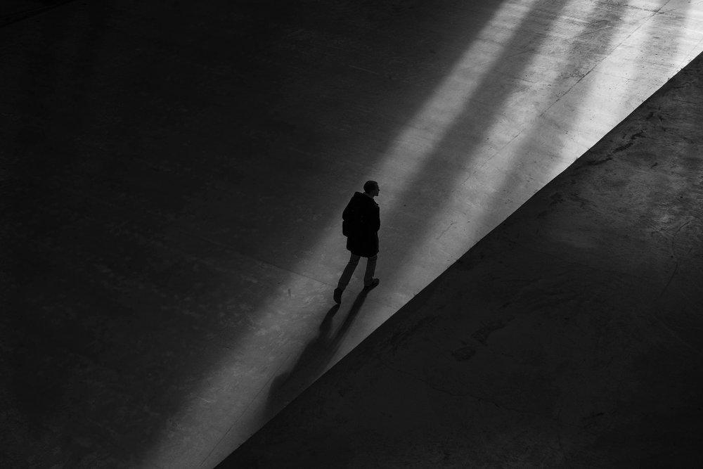 Shadow man walking across floor.jpeg