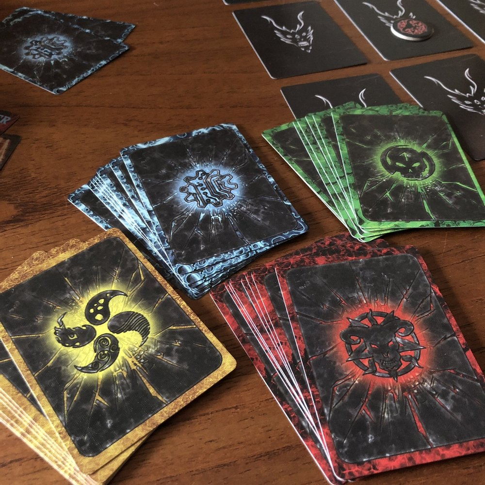 Pick your mage cards: Demonologist (red), Necromancer (green), Technomancer (blue), or Elementalist (yellow). Each mage has their own special power that they can use once during the game. If they choose not to use their power, they earn an extra point at the end of the game.