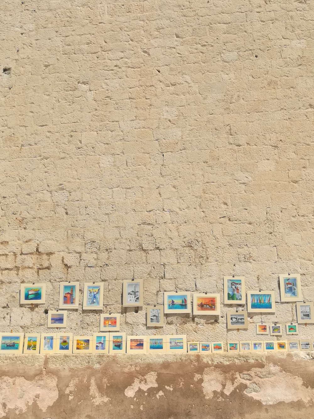 Local artists work against bricks that could tell 1000 stories
