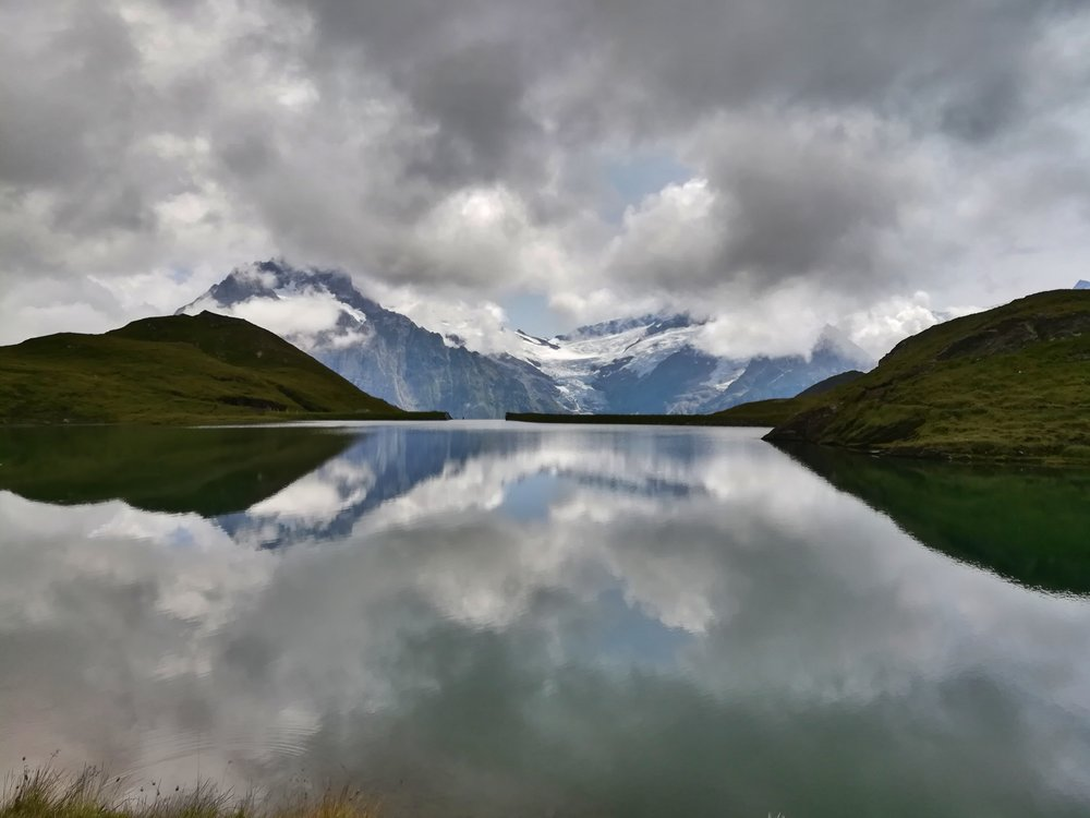 Reflections in a lake on top of the alps