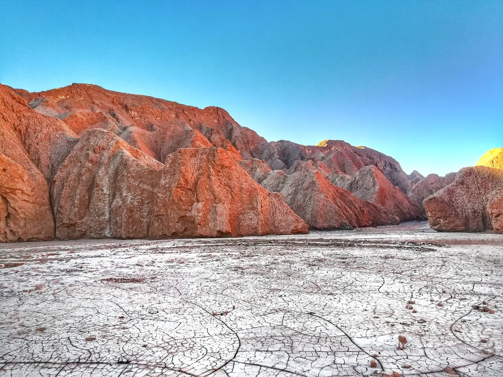 Blue skies, red hills, and white salt