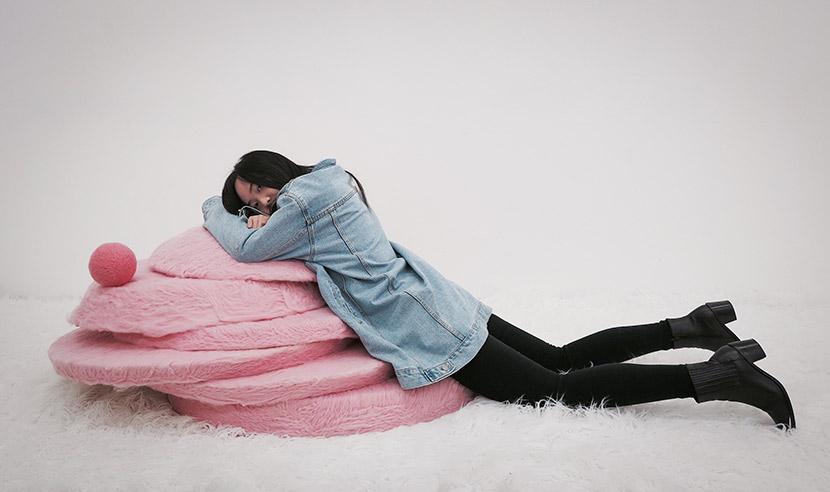 stARTup SF 2017    exhibitor Weijue Wang posing with her feminist felt art