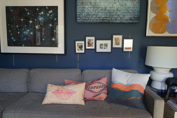 A cluster of  Ray Beldner's collages  fill an opening between large scale works to complete a grouping of ethereal art pieces in blue and orange.