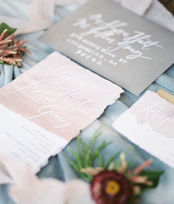 Gorgeous shot by the talented @stephaniefishbeinphoto! I loved getting to work with handmade paper and calligraphy. Not our usual style, but love it nonetheless! ⠀⠀⠀⠀⠀⠀⠀⠀⠀ Wedding designer: @byjasonlloyd Florals: @theflowermethod Stationery/Calligrapher: @feelgoodpaperco Hair & Makeup: @hairbynikirae  Dress: @bridelosangeles  Cake: @snackbytiffany Rentals: @provenancerentals Rings: @suneerajewlry Venue:@greatspiritsranch . . . . #weddinginvitations #wedding #ocwedding #engaged #weddinginvites #weddingstationery #socalwedding #brides #californiawedding #dailydoseofpaper #invitations #socalbride  #weddingideas #bohowedding #bohobride #bohostyle #weddingdetails #orangecountywedding #socalweddings #socalwedding #texaswedding #femaleentrepreneur #dailydoseofpaper #pinkwedding  #colorpalette #weddingcolors #destinationwedding #destinationweddings #modernwedding #modernweddings