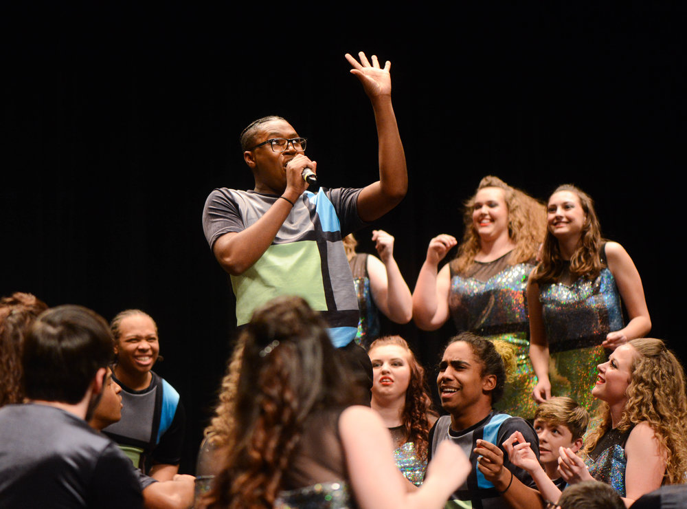 Battle junior Jermon Lambert sings a solo during the benefit concert on Thursday at Rock Bridge High School. Battle High School and Rock Bridge came together to raise money for Children's Grove.