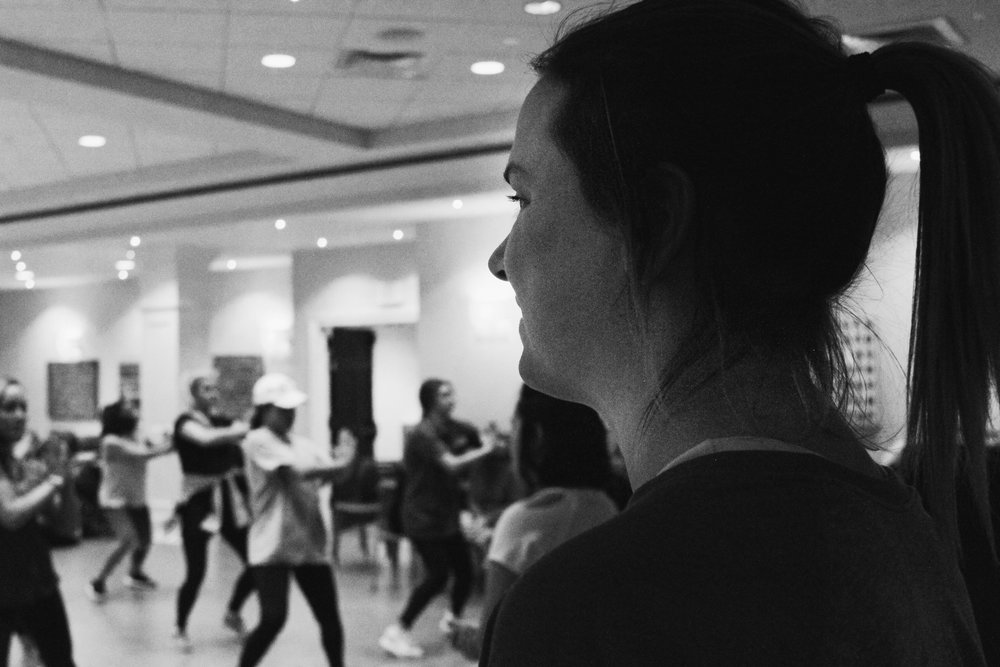 Jessica Soehlke watches as her sorority sisters practice their dance routine for the philanthropic event, Rockin' Against Multiple Sclerosis. The event's purpose is to raise money and provide services for the MS Institute of Mid-Missouri.