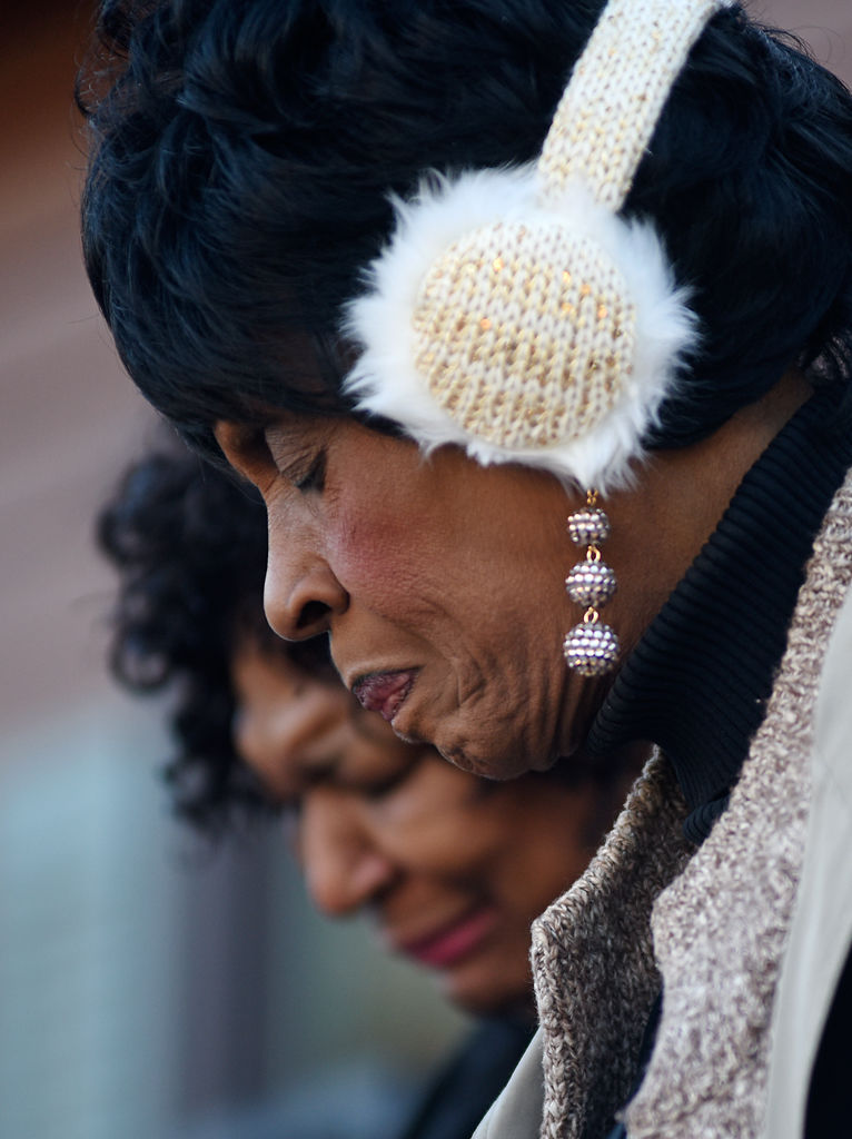 "Columbia NAACP president Mary Ratliff, front, and Rev. Myra Drummond-Lewis bow their heads to pray during a Martin Luther King Jr. 50th year memorial service Wednesday at the J.W. ""Blind"" Boone Home gardens in Columbia. Ratliff led the service, which was sponsored by Columbia NAACP."