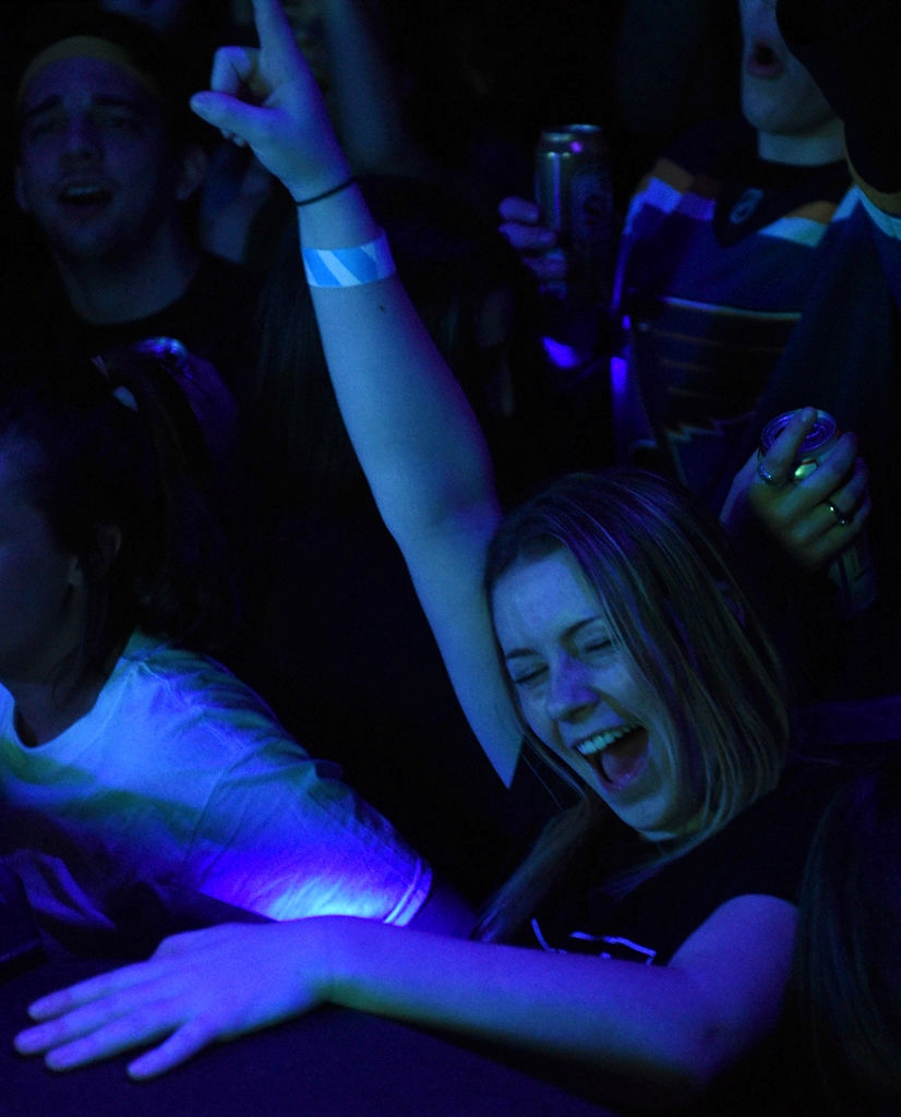 "A partygoer dances at ""Home Bass,"" the Mizzou Electronic Music Organization's free monthly event on Feb. 21 at Rose Music Hall in Columbia. MEMO brings in local small-time DJs to headline the shows."