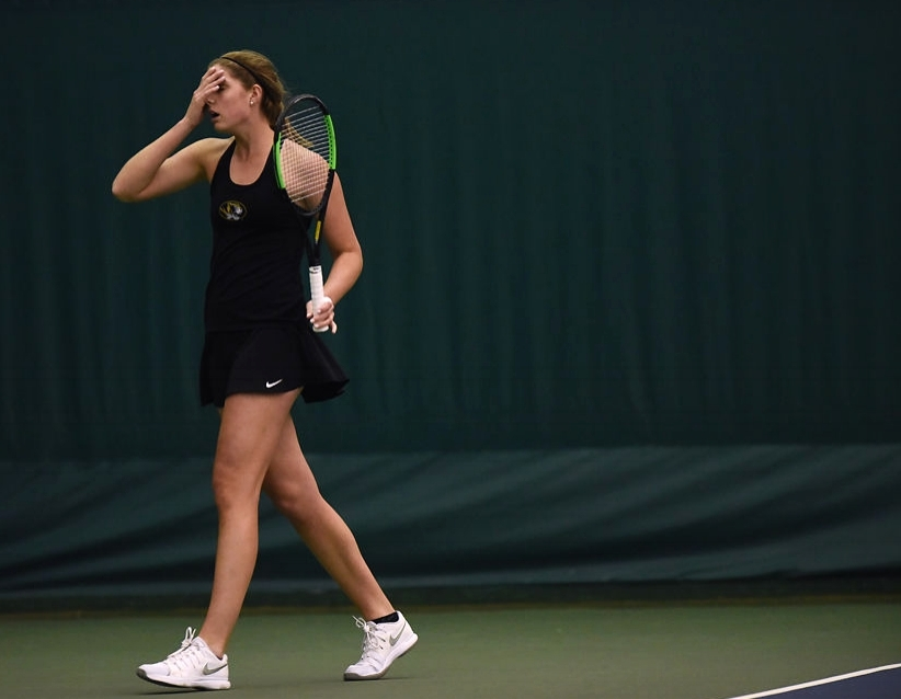 Missouri's Mackenzy Middlebrooks covers her face after dropping a point to Alabama's Jacqueline Pelletier during a singles match Sunday at the Mizzou Tennis Complex. Middlebrooks rebounded and won the match.