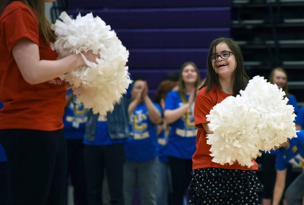 Julianna Basi smiles after completing a cheer routine Thursday during the United Challenge at Hickman High School. United Challenge is an annual competition for students with special needs in ninth through 12th grade in high schools across the district.