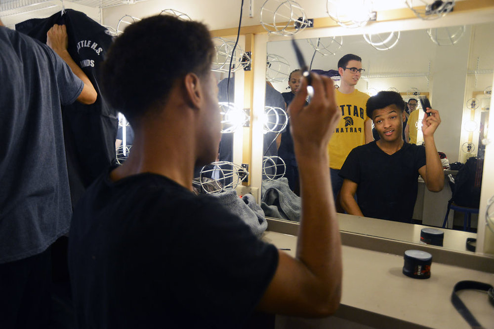 Battle senior Marlin Allen combs his hair before performing at the charity concert benefiting Children's Grove on Thursday. Allen is a part of Battle's show choir group Battalion, a mixed choir.