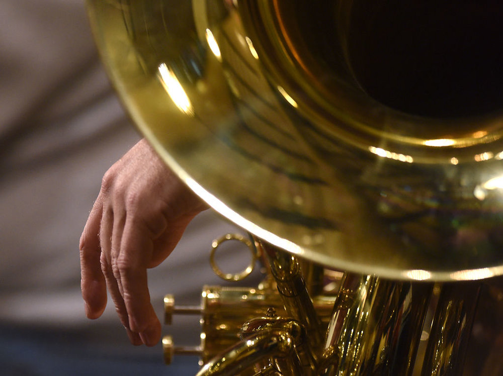 A member of the Columbia Community Band rests against their instrument before rehearsal Wednesday at the Missouri United Methodist Church. The band's concert this weekend will feature music by Missouri composers.