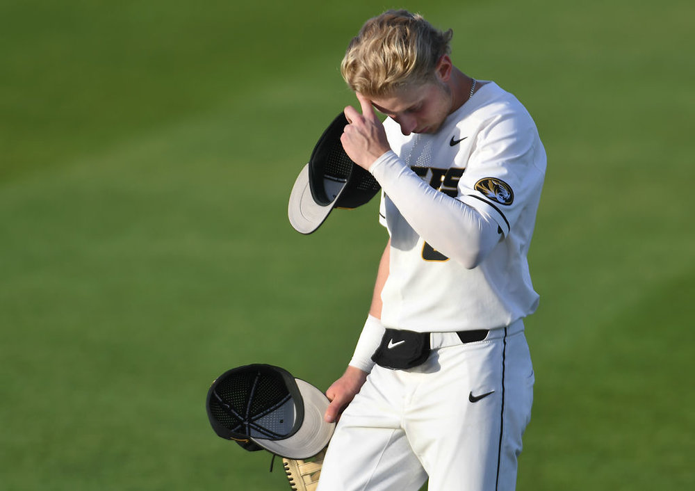 Missouri's Connor Brumfield walks toward his teammates holding right fielder Cade Bormet's hat during a game against Georgia on Thursday at Taylor Stadium. Bormet was knocked unconscious after sliding into the brick wall down the right field line and broke several bones in his face, including the orbital bone.