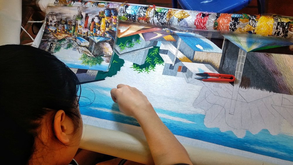 ARTIST CREATING HAND-STITCHED PHOTO OF PEOPLE IN THE FIELDS OF HANOI, VIETNAM