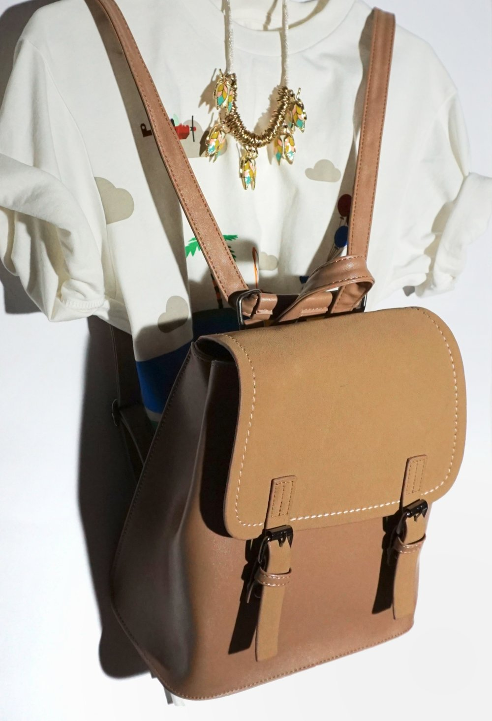 the camel-colored backpack makes me feel positive things. -
