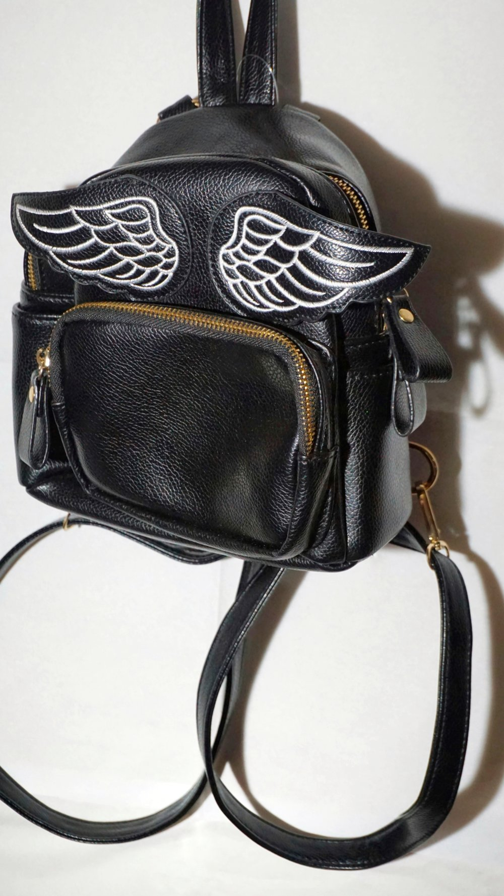 the wings of this bag call out to theAngels & Airwavesfan girl in me. -
