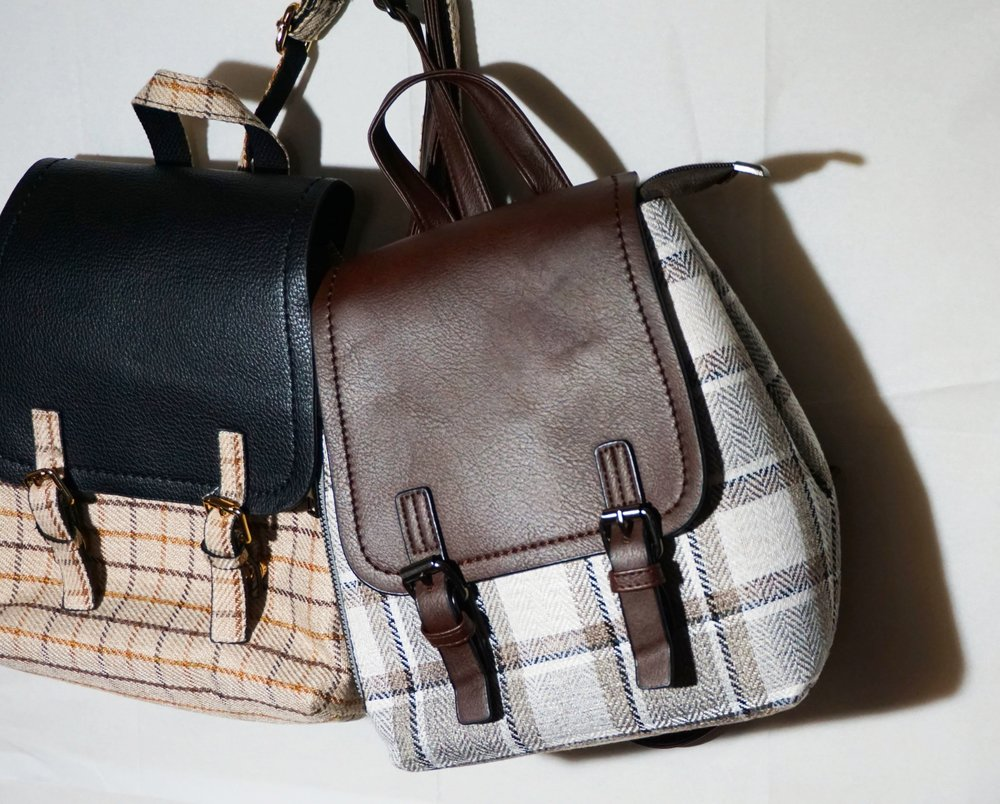 checked bags are at once novel and classic.and Plaid never goes out of style. -