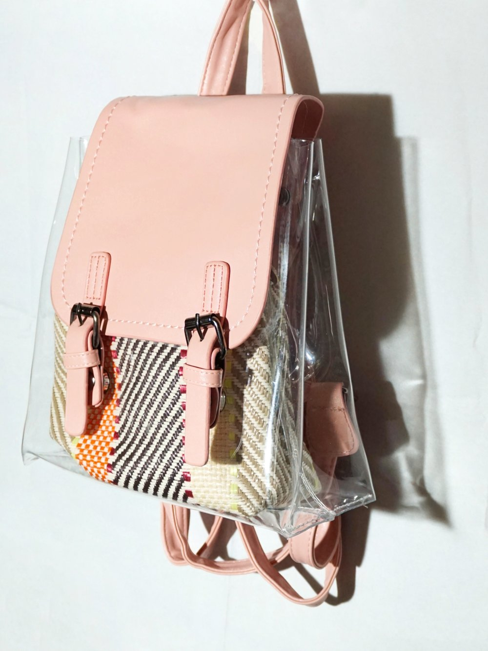 by the way, you can take out the colorful little pouch inside to make your bag 100% transparent. -