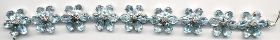 cc_flower_motif_bracelet_of_faceted_blue_topaz_prong-set_set_in_sterling_silver.jpg