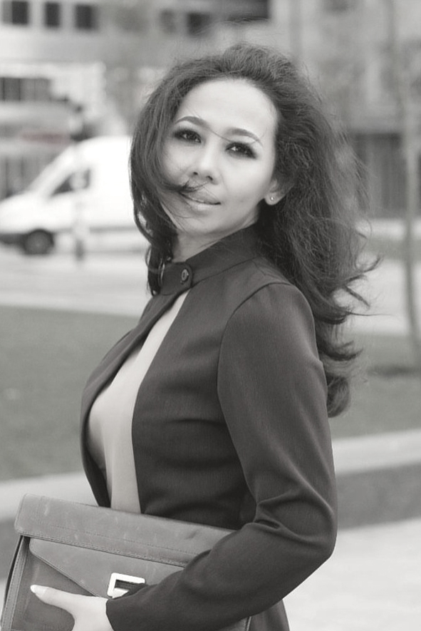 Ernia Santawie - My name is Ernia Santawie. I was born in Indonesia on 29 september 1975. I'm the 4th child of 6 sibling and I lived in the Netherlands from 2005. I started my career by working in hotel because I am a graduate of hospitality, but from 1998 I was interested to be designer, for that I try to learn how to make my own clothes and I had learned to sew 3 months and stopped just because I was too busy with my job, after I stayed in Netherlands I became interested again with my hobby as a designer and finally I went to school in Beauty Nederland School of designer's department, after I graduated I started to follow some fashion show and race event fashion night in Rotterdam and Angola Fashion Award and I won and it made me motivated to continue the hobby.Design I create is unique, elegance, chic with sexy touch. And I hope in the future I can become a famous designer and fashion is my passion.
