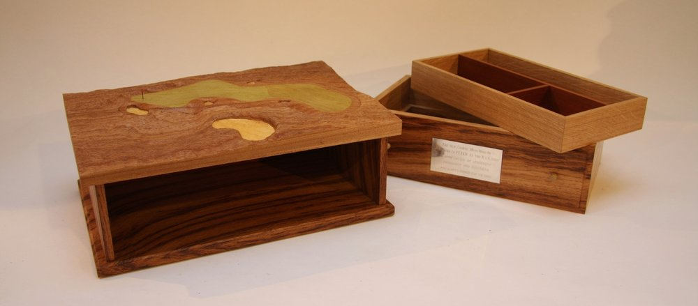 A presentation replica, like this one of the 11th hole on the Old Course, St Andrews, makes an excellent retirement gift. This English elm and brown oak piece, with drawers and even a secret compartment, was commissioned by the Royal & Ancient as a note of thanks for their Chief Executive, Peter Dawson at the end of his illustrious and long leadership