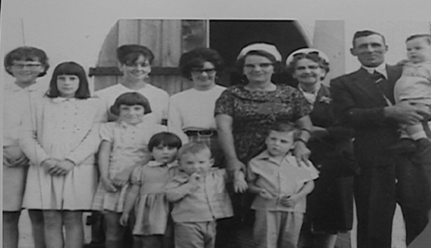 The Peterson family of Shell Lake, Saskatchewan. From left to right: Mary, Dorothy, Jean, Pearl, Phyllis (survived), Kathy (not in the house at the time of massacre), Colin, Evelyn, William, Martha (grandmother, not in the house), James and baby Larry.