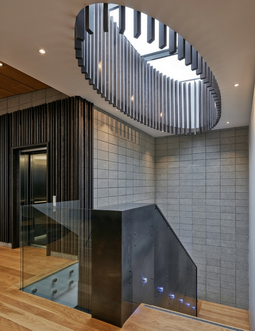 staircase skylight - Natural lighting from the skylight is diffused through the stunning detailing over the staircase.