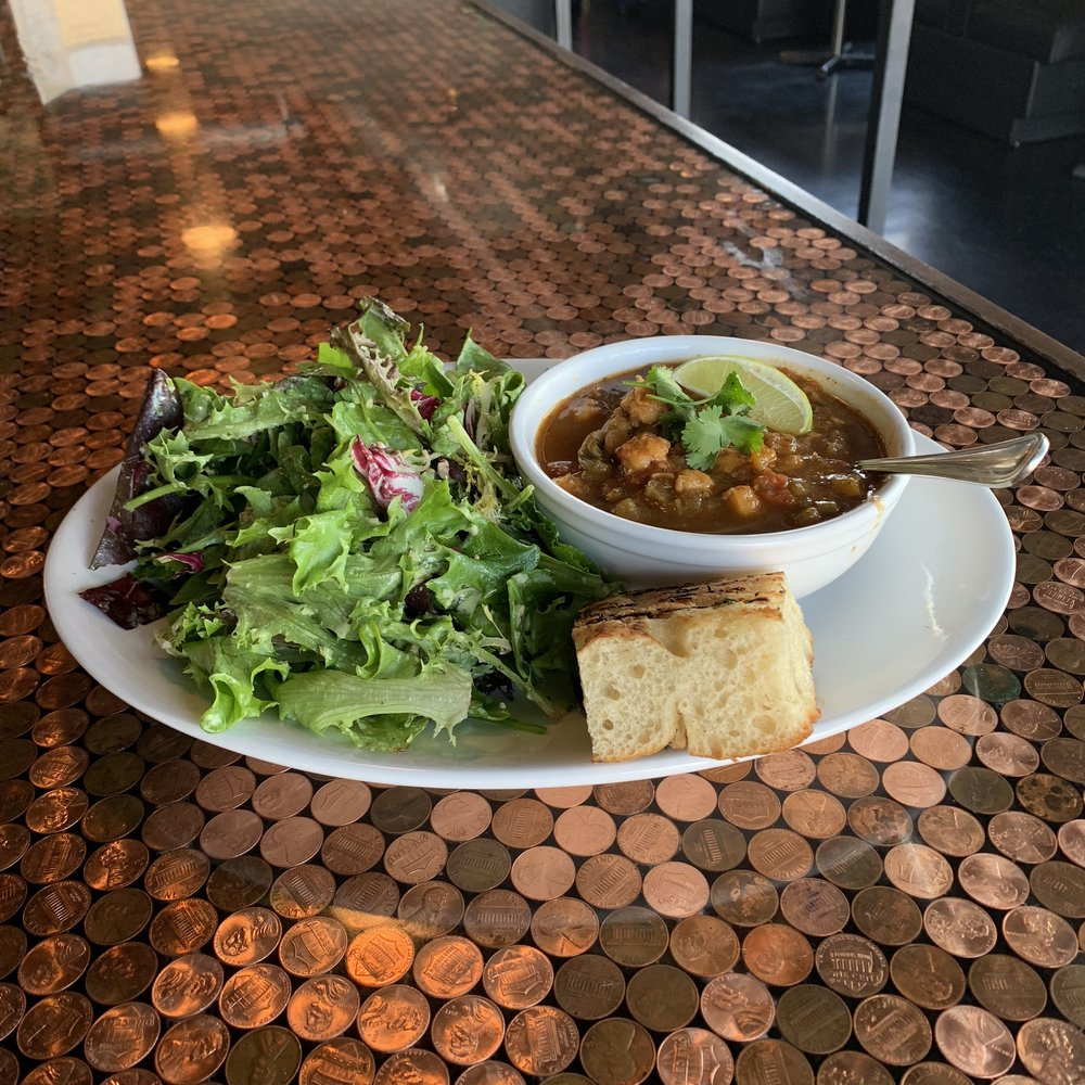 BOWL OF SOUP & GREENS - We always have a veggie (or vegan) soup and a meat soup option. They're made in house and rotate throughout the week. Served with Grand Central Bakery bread.
