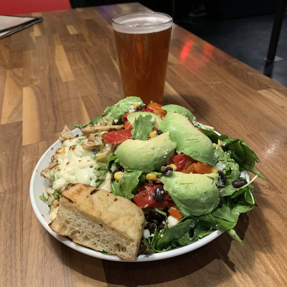BLACK BEAN & CORN - Mixed greens, arugula, avocado, mama lil's peppers, cotija, served with our cilantro lime dressing. Add any protein for $4 - we recommend the chicken chile verde!