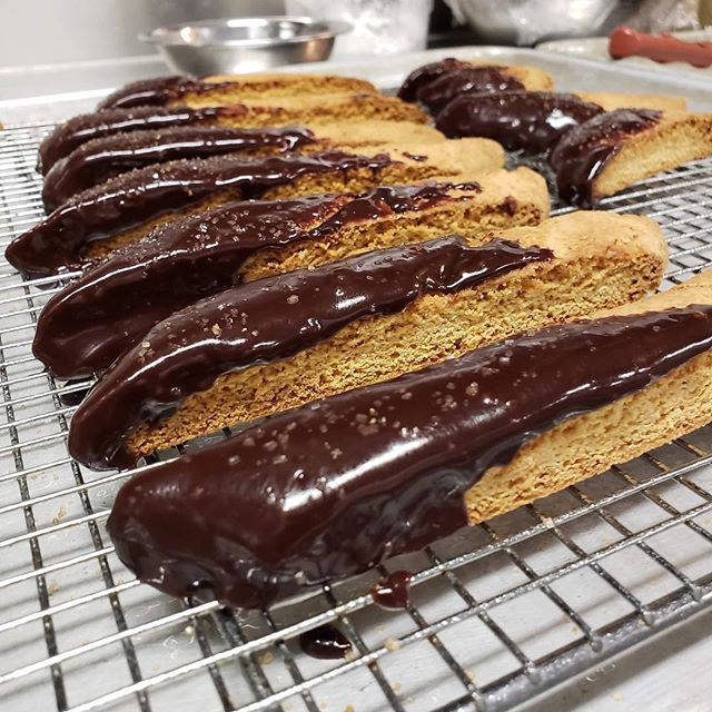 Time to make the biscotti! Almond and Orange Zest Biscotti dipped in Chocolate and dusted with Demerara sugar 🍊🍫☕️ available today! #StAnthonysFeast2018