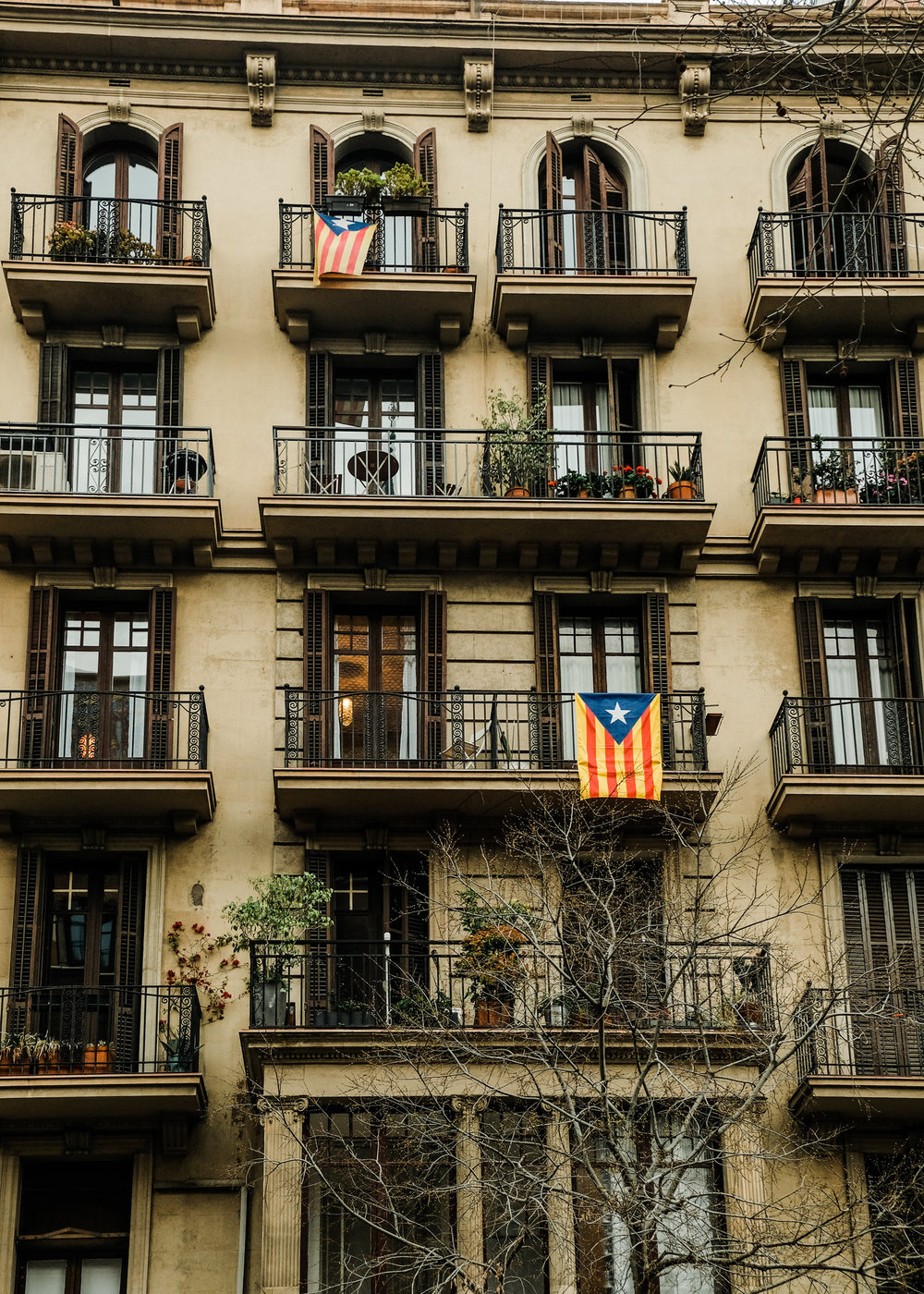 La Estelada Blava, the most popular flag that one will notice on display in Barcelona stands as the symbol of the separatist movement in Catalonia and represents their desire to gain independence from the rest of Spain. In a time as politically turbulent as the present, hanging a flag is the resultant of the human need to identify oneself as a member of a group in terms of political preferences, and to express to the world one's opinion.