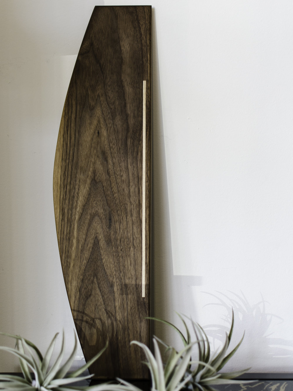 Allison SamuelsServing Board - This piece has the most beautiful inlay and striking overall shape. I can picture my mom piling snacks on top to offer to her friends when they stop by, being the great host she is!