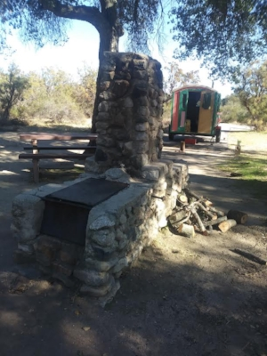 Oak Grove Campground. Vintage barbecue and pile of firewood.