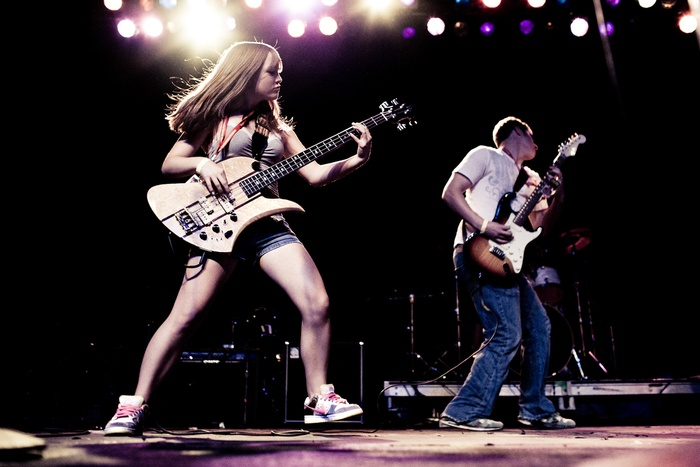 Girl_and_Boy_Playing_Guitar_on_Stage-small.jpg
