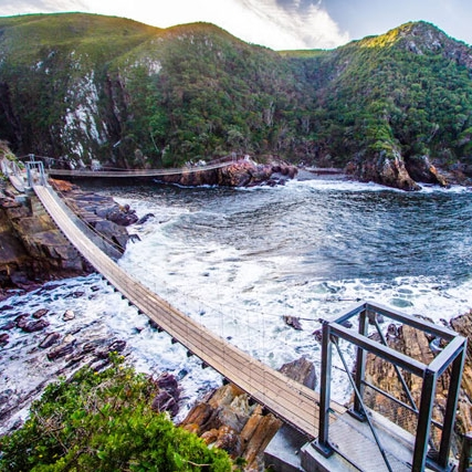 Walking over Storms River suspension bridge -