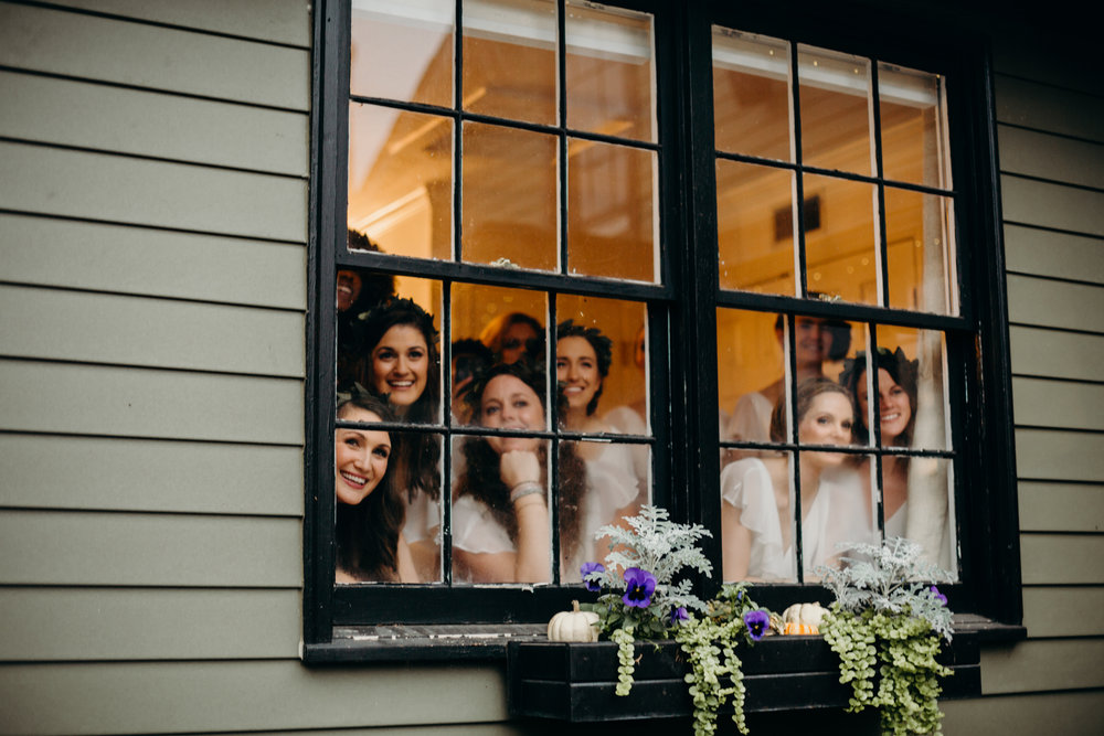also the bridesmaids watching the first look from the window is literally one of my favorite things.